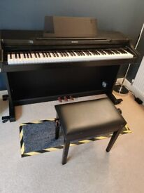 Technics SX-PX552 digital piano. Including seat and mat.