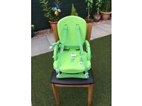 Feeding/play deluxe folding booster seat.