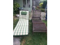 2 x wooden garden loungers with padded covers for both.