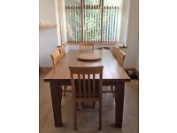 Six solid oak dining chairs from John Lewis and Chunky pine table (Ikea)