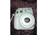 Baby blue Polaroid camera instead mini 8