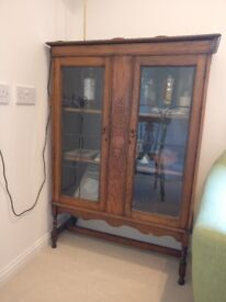 Antique glass-fronted display cabinet
