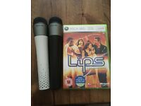 Xbox 360 two wireless microphones plus game.