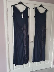 Beautiful navy floor length dresses... brand new not worn with labels on.