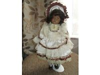 porcelain dolls excellent condition with boxes and stands