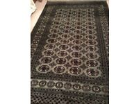 Green, red, cream and black signed Persian rug