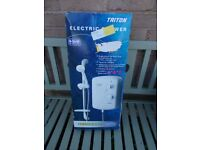 Brand new boxed Triton electric shower