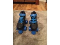 Nearly New Roller boots. Never worn outside size 2