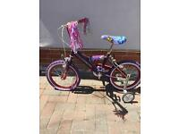 Girls bike with stablizers