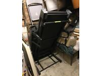 Treadmill with TV screen and automatic incline