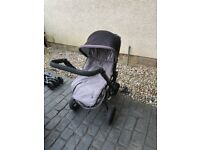 Original Jane grey and black pram with raincover and cosy toes