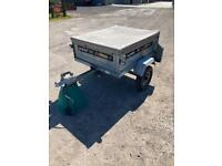 Small camping trailer with new cover