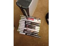 Xbox 360 with COD games plus Wireless Race Wheel and driving games and two controllers