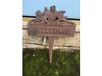 "Metal sign saying ""Welcome"" that you plant into the ground. £4 each"