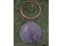 Round cast iron manhole cover
