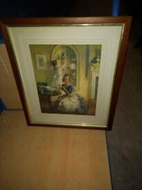 picture of mother and daughter in brown wood frame