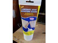 Laminate joint moisture guard,
