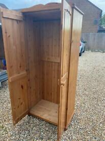 Solid chunky pine wardrobe. Possible delivery