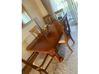 Extendable 6 seater polished wooden dining table with 6 chairs & matching cabinet
