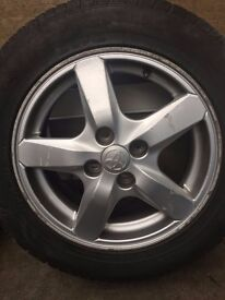 """15"""" Toyota alloy wheels set with good tires"""