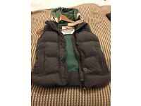 Super dry XSMALL super dry gilet. Excellent condition. Grey with green hood.
