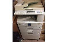 Ricoh Aficio 2020 B&W photocopier, printer and scanner for sale.