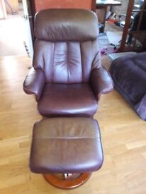 Brown leather chair with separate footstool