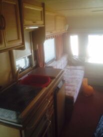 1998 4/5 berth caravan and awning for sale