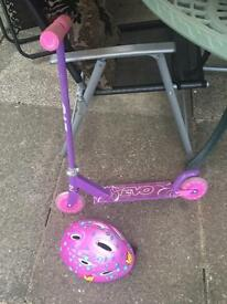 Pink scooter and helmet