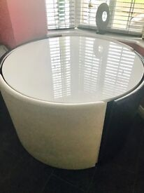 white gloss round hideaway table and four seats