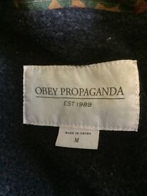 Obey camouflage jacket with fur-lined hood. Barely worn, size medium
