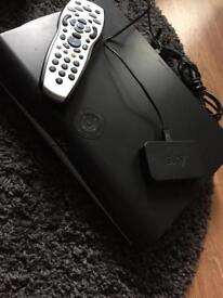 Sky. Box with remote