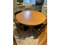 Mid-century round extending dining table and 4 chairs
