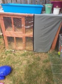 Rabbit hutch 1-2 yrs old. Like new+ plastic rabbit/animal indoor cage