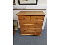Lovely pine chest of 2 over 4 drawers on bun feet, great condition