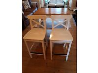 Ikea kitchen table with steel shelves and two kitchen stools