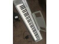 Yamaha portable grand piano/keyboard NP-30