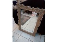Elegant mirror with carved design wooden frame