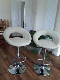 Two breakfast bar chairs in cream faux leather