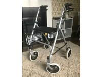 4 wheeled walking aid with seat