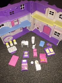 Doll house small, part furnished, folds and has doorbell