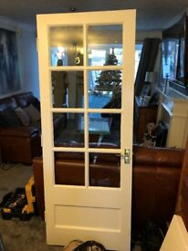 Solid internal wood doors with 8 glass panels