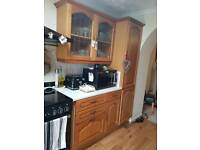 Solid oak kitchen. cupboard units with work tops and sink