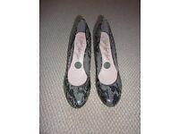 Snake skin heeled shoes