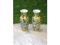 Small yellow and blue matching Chinese vases