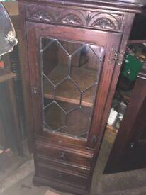 Jaycee narrow dark oak lead glass door two draw bookcase