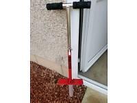 Red metal pogo stick