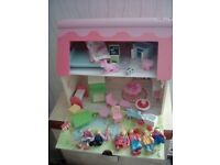 A lovely Dolls House as shown. plenty of furniture and 7 Figures. All Excellent.