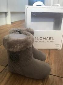 Michael Kors Baby Boots with fur trim.