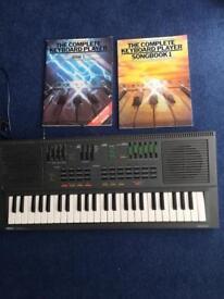 Yamaha PortaSound pss- 460 Keyboard/Synthesizer with 2 Keyboard Music books.